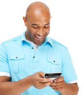 Man texting and enjoying it