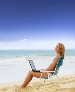 Woman at the beach with laptop