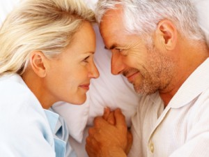 Older couple smiling in bed
