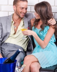 Couple touching and enjoying drinks