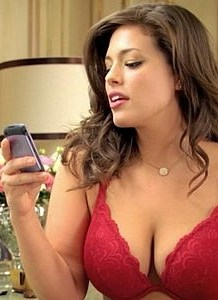 Big-breasted woman texting