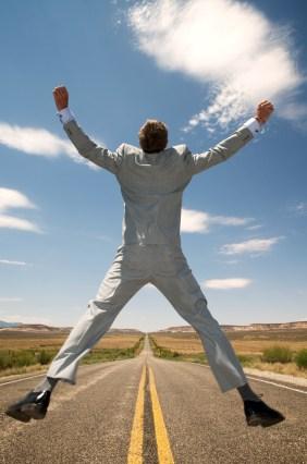 Man jumping above road
