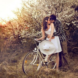 Couple on bike kissing