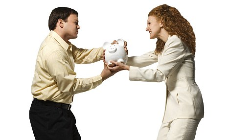 Man and woman fighting over piggy bank