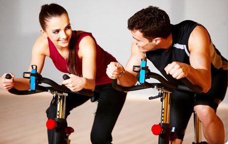 Couple getting to know one another at the gym