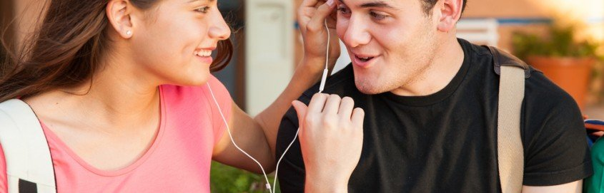 guy and girl listen to music together
