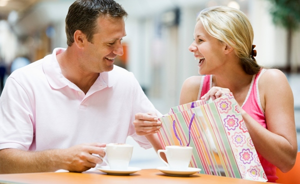 Couple laughing over coffee