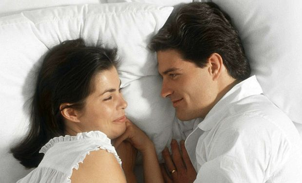 Couple having a good chat in bed