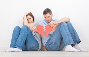 discussing couple broken heart holding