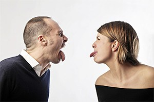 Couple making nasty faces at each other.