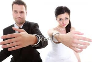 unhappy bride and groom cuffed