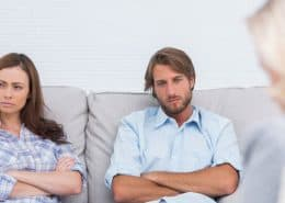 unhappy couple sees marriage counselor