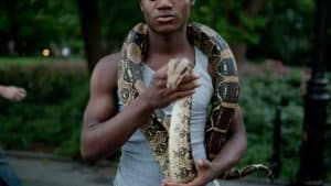man with snake as scarf