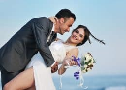 a happy wife is held up by her husband