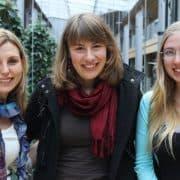three happy women posing on the street