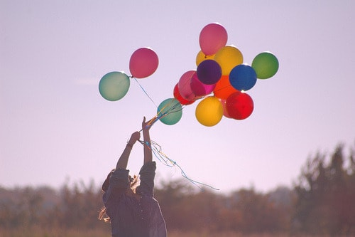 letting balloons go