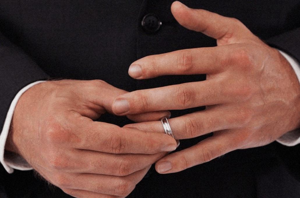 man removes ring
